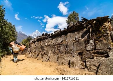 Porter with Mani Stone at Phakding, Trekking Route to Everest Base Camp (EBC), Nepal