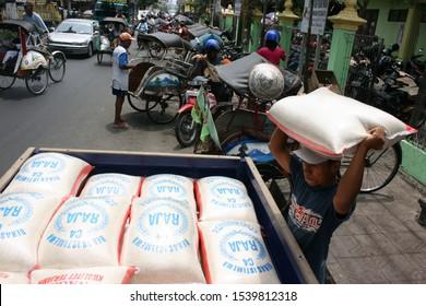 porters carry rice at the Demangan market, Yogyakarta, November 9, 2008