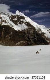 Porters carrying loads across snowy pass,Chyungma PassKhumbuNepal