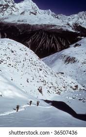 Porters near Ganja La leaving Lantag Valley,  Langtang Himal, Himalayas,  Nepal, Asia