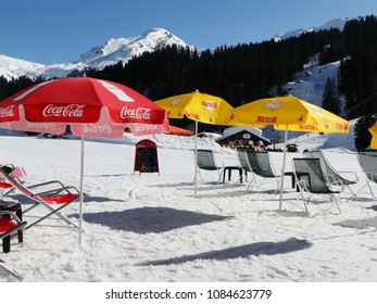 PORTES DU SOLEIL, FRANCE - FEB 27, 2012 - Red and Yellow umbrellas at an outdoor restaurant at a ski area  near Avoriaz, France