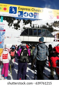 PORTES DU SOLEIL, FRANCE - FEB 27 - Kids wait in the lift line  on Feb 27, 2012 near  Avoriaz, France