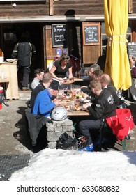 PORTES DU SOLEIL, FRANCE - Mar 3 - A group of skiers have a leisurely lunch outdoors on Mar 3, 2012, at the Portes du Soleil, France.