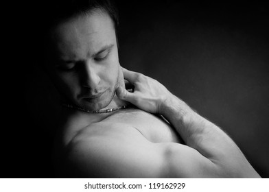 Portet muscular man with a beautiful body. black-and-white photo