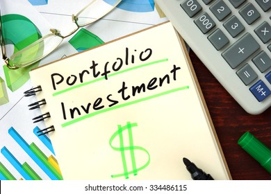 Portfolio investment  concept. Notepad on the table.