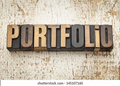 portfolio word in vintage letterpress wood type on a grunge painted barn wood background