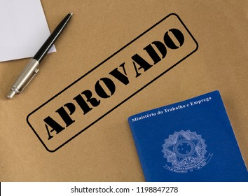 """Portfolio work permit of """"Ministry of Labor and Social Security of Brazil - CTPS"""" (translation) and pen on brown paper envelope with approved stamp (translation: approved)"""