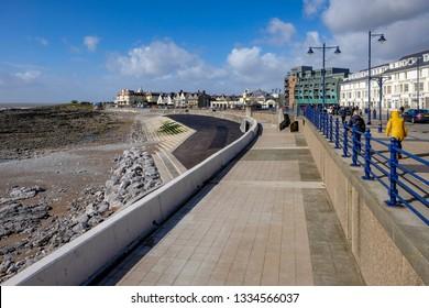 Porthcawl, Wales/ UK - 03/10/19: View of promenade and sea defences, looking towards Sea Bank Hotel