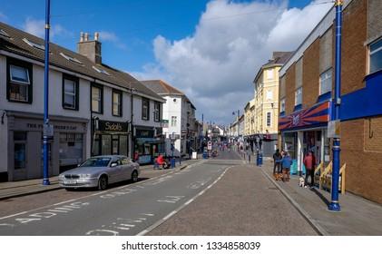 Porthcawl , Wales /UK - 03/10/19: View along John Street and shopping precinct