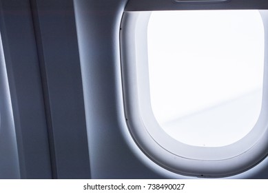 Porthole in passenger cabin on the plane