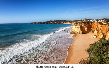 Portimao, city on the Atlantic coast at sunset, red cliffs and sandy beach, Beautiful seascape, Algarve, Portugal