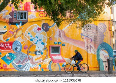 PORTIMAO, PORTUGAL: 20th MAY 2018 - Beautiful graffiti art on Portimao city depicting youth elements like technology, sex, drugs, soda and others.