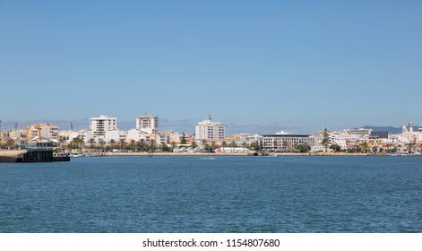 PORTIMAO, PORTUGAL- July 27th, 2018: View of Portimao harbour with palm lined promenade.