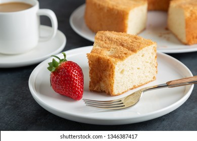 Portion of angel food cake served with strawberries