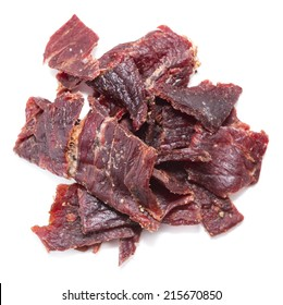 Portion of Beef Jerky (close-up shot) on pure white background