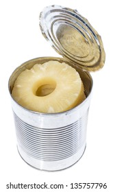 Portion of canned sliced Pineapple in a tin isolated on white background