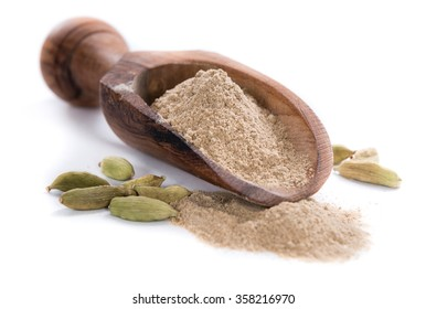 Portion of Cardamon Powder (close-up shot) isolated on white background