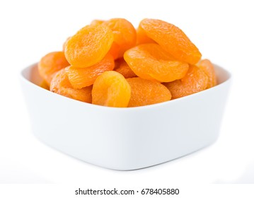 Portion of Dried Apricots (as close-up shot) isolated on white background