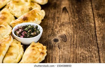 Portion of fresh homemade Empanadas as detailed close-up shot; selective focus
