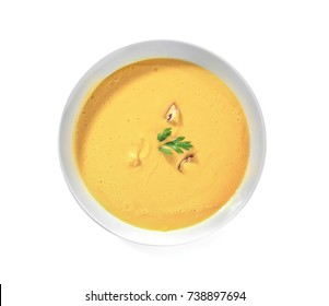 Portion of fresh homemade lentils cream soup in plate on white background
