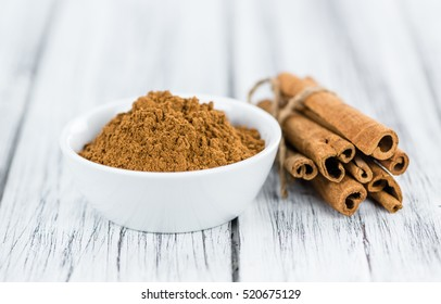 Portion of fresh made Cinnamon (close-up shot; selective focus)