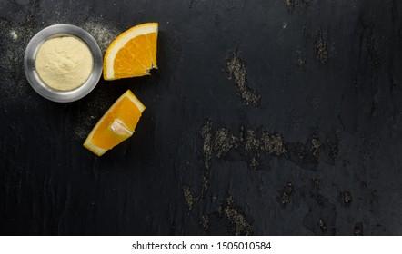 Portion of fresh made Orange Powder as detailed close-up shot (selective focus)