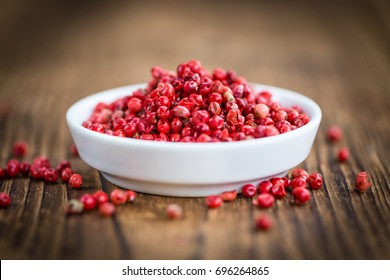 Portion of fresh Pink Peppercorns  close-up shot; selective focus