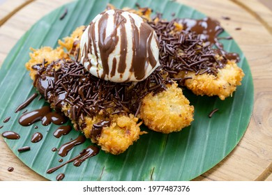A portion of fried banana with ice cream
