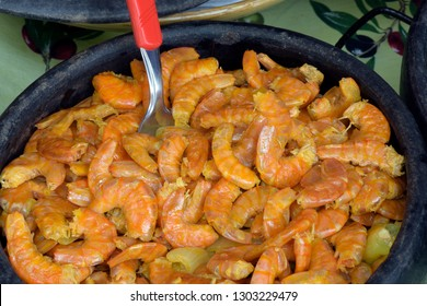 Portion of fried shrimp, one of the fillings of the traditional Afro-Brazilian dish acaraje, in clay pan