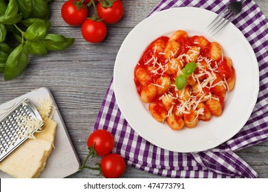 Portion of gnocchi in tomato sauce with cheese.