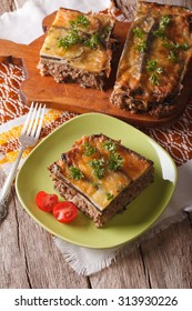 Portion of Greek moussaka with eggplant on a plate close-up. Vertical top view