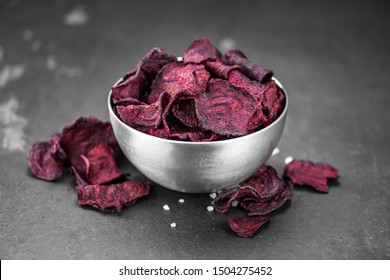 Portion of healthy Beetroot Chips on a slate slab (selective focus)