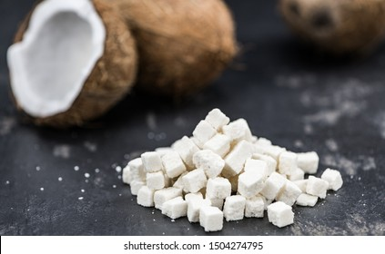 Portion of healthy Coconut dices (selective focus; close-up shot)