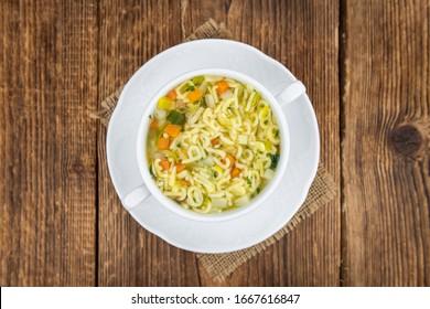 Portion of homemade Alphabet Soup (selective focus; close-up shot)