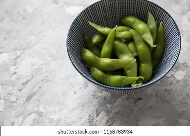 Portion Japanese Edamame soy beans in porcelain bowl