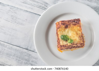 Portion of lasagne on the wooden table
