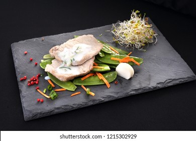 A portion of meat with vegetables. Dietary dinner dish