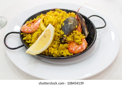 Portion of paella served in traditional metal plate