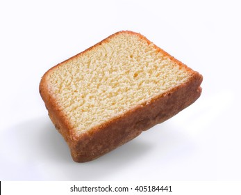 Portion of a pound cake on white background
