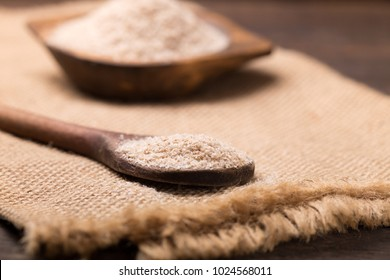 Portion of Psyllium  on rustic wooden background