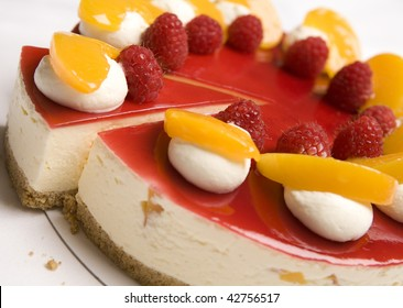 A portion of Raspberry & Mandarin cheesecake