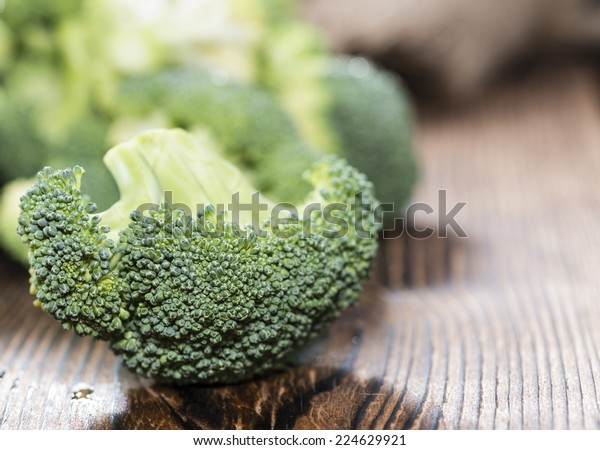 Portion of Raw Broccoli on dark wooden background