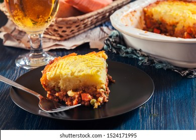 Portion of shepherd's pie or cottage pie on a plate. British cuisine.