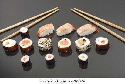 portion sushi on black plate