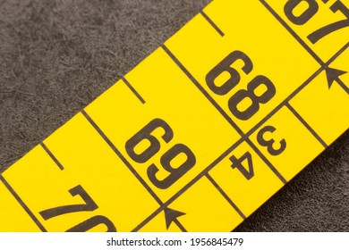 Portion of a tape measure, enlarged image of a centimeter on a color tape measure