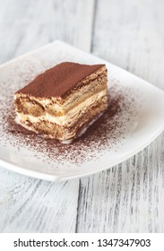 Portion of tiramisu on the white plate close-up