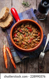 Portion of traditional  beef stew with carrots, red peppers and mushrooms