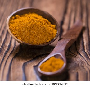 Portion of Turmeric (selective focus) on an old wooden table