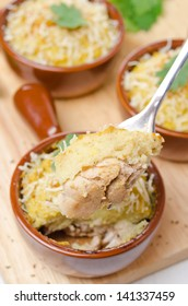 portioned form with baked chicken with mashed cauliflower and cheese