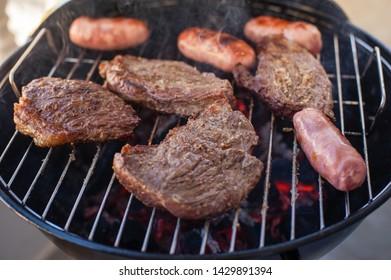 Portions of picanha Barbecue beef barbecue on portable barbecue red meat picanha made on the grill